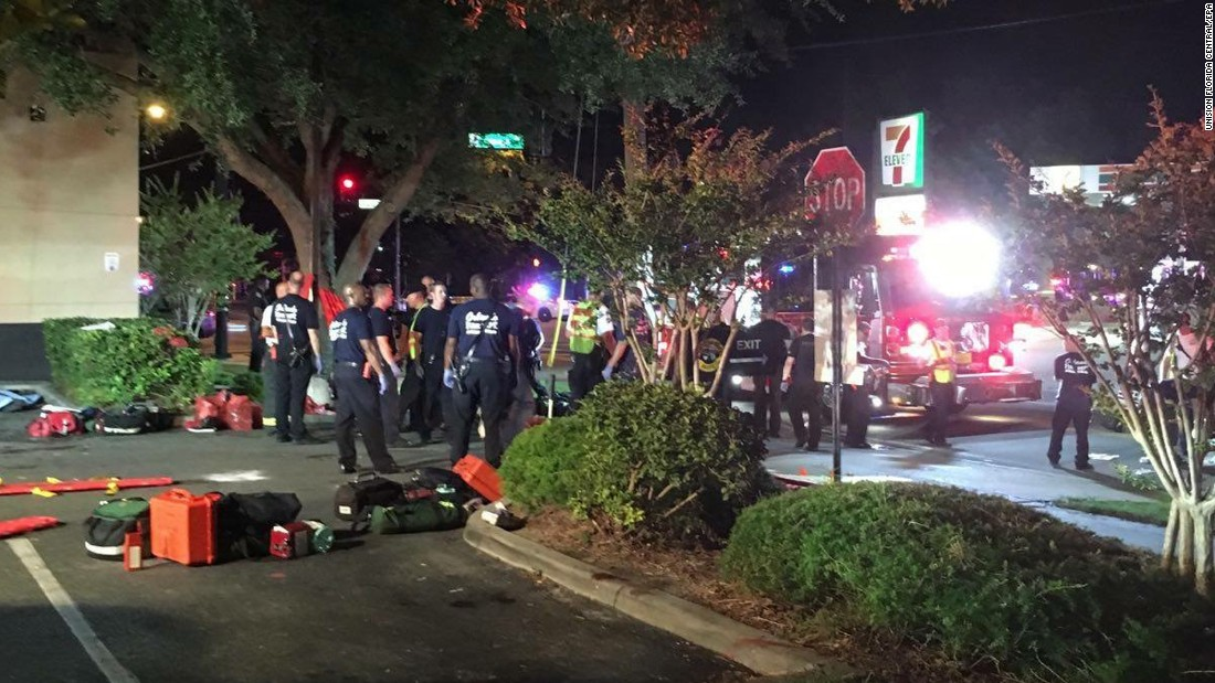 Emergency personnel gather outside the nightclub.