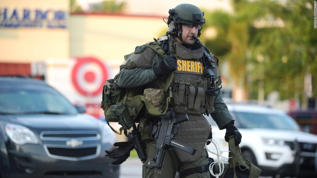 A SWAT team member arrives at the scene of the shooting.