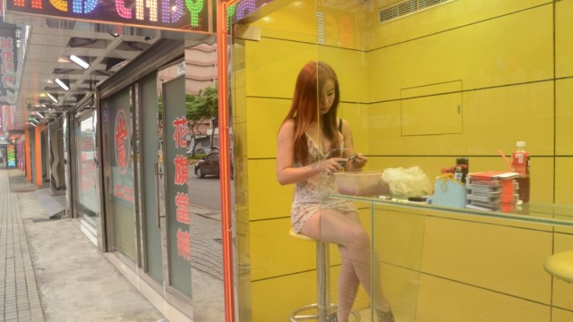"""Along the streets and highways in Taiwan  -- especially in the cities' outskirts and in the countryside -- are neon-lit booths with scantily clad """"betel nut beauties."""""""