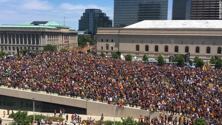 """Fans gather to watch the parade in Cleveland. The city hadn't won a major sports title since 1964. <a href=""""http://www.cnn.com/2016/06/20/sport/gallery/cities-longest-championship-droughts/index.html"""" target=""""_blank"""">See other championship droughts</a>"""