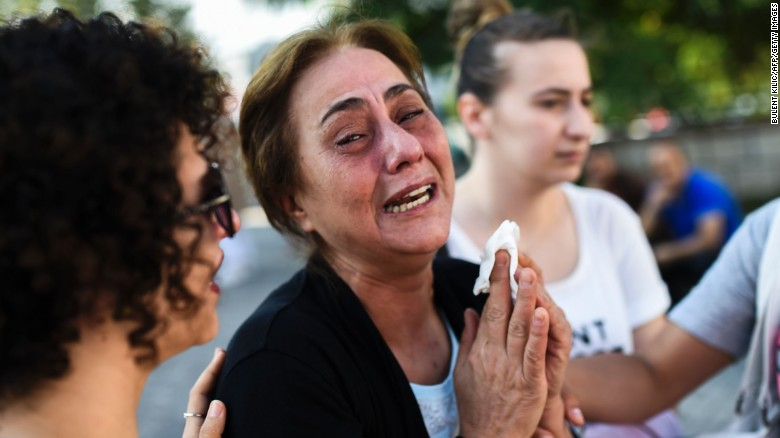 A mother of victims killed the day before in a suicide bombing and gun attack at Istanbul's airport, cries on Wednesday, June 29, in Istanbul.