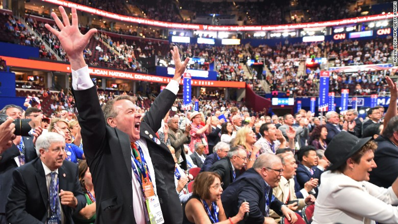 A delegate cheers during the roll call of states on the second day of the Republican National Convention on July 19, 2016 at Quicken Loans Arena in Cleveland, Ohio.  About 50,000 people are expected in Cleveland this week for the Republican National Convention, at which Donald Trump is expected to be formally nominated to run for the US presidency in November.