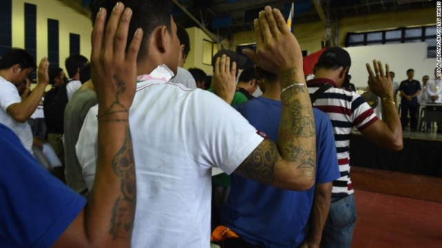 Some 1,000 people whom authorities accused of being drug users and dealers take an oath before local authorities after turning themselves in in Tanauan, the Philippines, on July 18, 2016. Philippine President Rodrigo Duterte swept to power on a promise to clamp down on drugs in a two-month crime blitz, encouraging police and even civilians to shoot drug dealers. The country has seen a surge in killings of suspected dealers.