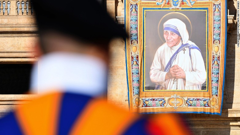 An image of Mother Teresa hangs from the facade of St. Peter's in the Vatican.