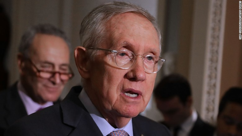 =Senate Minority Leader Harry Reid (D-NV) talks to reporters following the weekly Senate Democratic policy luncheon at the U.S. Capitol September 13, 2016 in Washington, DC.