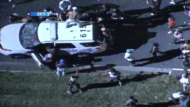 Video shows protesters attack police car
