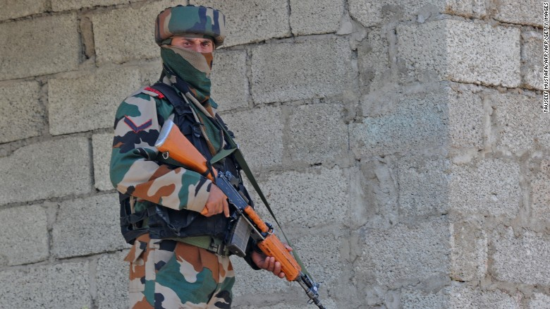 An Indian army soldier takes position during an army barracks attack, near the border with Pakistan, September 18, 2016.