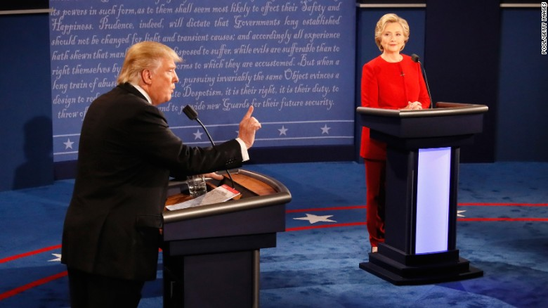 Donald Trump (L) speaks as Hillary Clinton (R) listens during the Presidential Debate at Hofstra University on September 26, 2016 in Hempstead, New York.