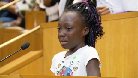 Image result for Girl weeps over police shootings at tense Charlotte meeting
