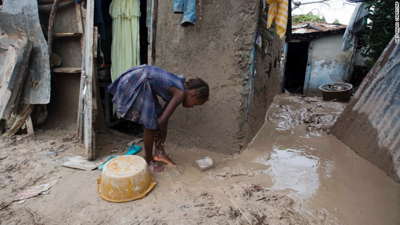 "A girl washes mud from her feet after Hurricane Matthew passed through Les Cayes, Haiti, on Thursday, October 6. <a href=""http://www.cnn.com/2016/10/04/americas/hurricane-matthew/index.html"" target=""_blank"">The damage from Hurricane Matthew</a> was especially brutal in southern Haiti, where sustained winds of 130 mph punished the country."