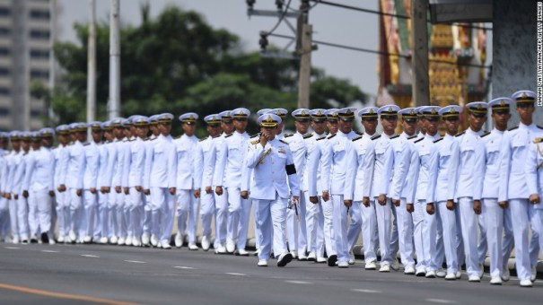 Thai army personel line up a street ahead of a procession for Thailand's King Bhumibol Adulyadej from Siriraj Hospital to the royal palace in Bangkok on October 14, 2016.