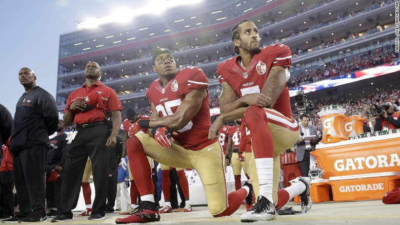 San Francisco 49ers safety Eric Reid (35) and quarterback Colin Kaepernick (7) kneel during the national anthem before an NFL football game against the Los Angeles Rams in Santa Clara, Calif., Monday, Sept. 12, 2016. (AP Photo/Marcio Jose Sanchez)