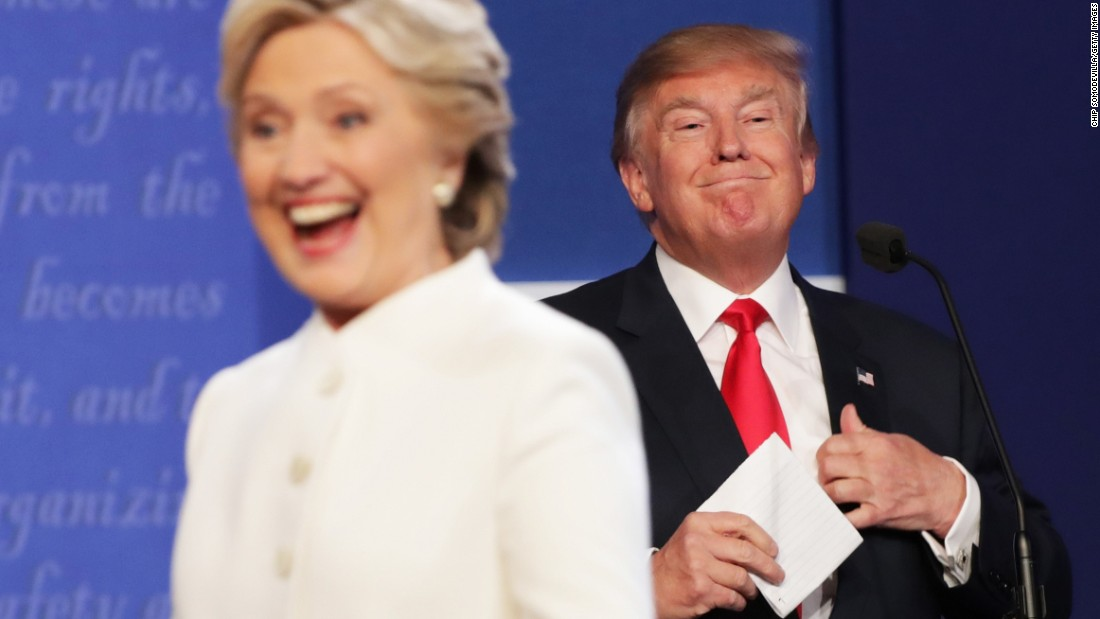 """Hillary Clinton gestures to the crowd after <a href=""""http://www.cnn.com/2016/10/19/politics/gallery/final-presidential-debate/index.html"""" target=""""_blank"""">the final presidential debate,</a> which took place Wednesday, October 19, in Las Vegas. There was no handshake between her and Donald Trump."""