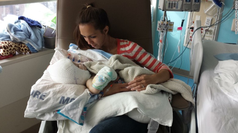 Nicole McDonald holds her son Jadon for the first time.