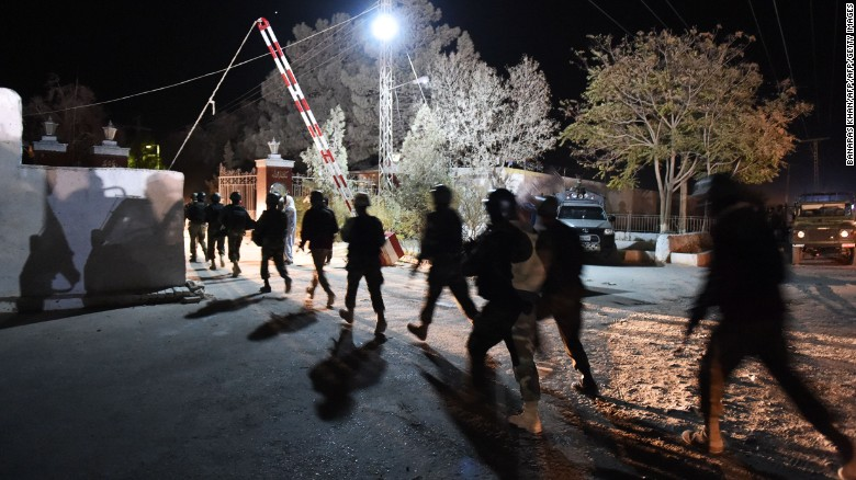 Pakistani soldiers arrive at the police training academy in Quetta after militants attacked Monday night.