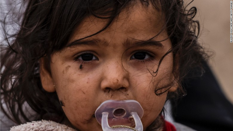 An Iraqi girl, displaced by the battle to retake Mosul from ISIS, is pictured near Qayyarah on Friday.