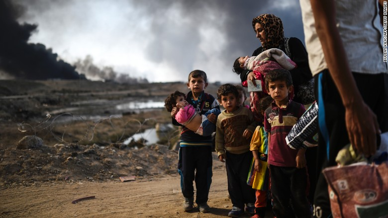 Iraqi families displaced by the ongoing operation to free Mosul are seen near Qayyarah, south of the city, on Saturday.