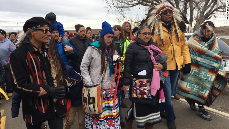 "Tribe members make their way back to the camp on Saturday, October 29. The <a href=""http://www.cnn.com/2016/09/07/us/dakota-access-pipeline-visual-guide/"" target=""_blank"">Dakota Access Pipeline</a> is a $3.7 billion project that would cross four states and change the landscape of the US crude oil supply. Construction of the pipeline will ""destroy our burial sites, prayer sites and culturally significant artifacts,"" the Standing Rock Sioux tribe said."