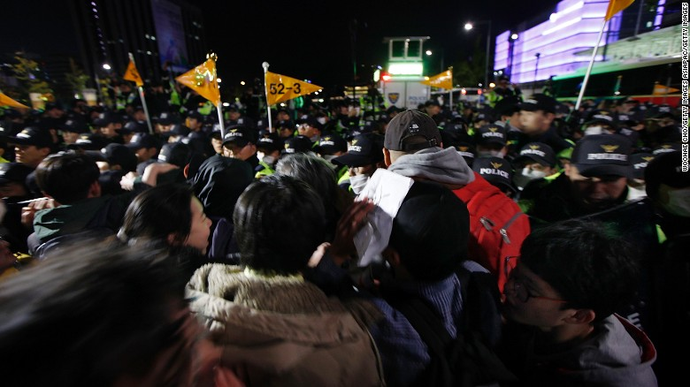Thousands of South Koreans took to Seoul's streets to demand President Park Geun-hye step down in the wake of allegations that Park let her friend, Choi Soon-Sil, interfere in important state affairs.