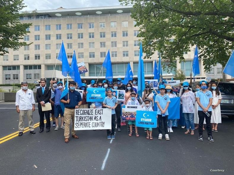 Uyghurs rally outside of the State Department