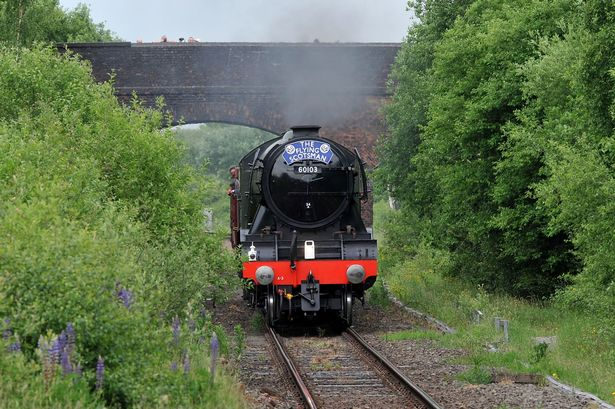 The Flying Scotsman pulls into Denton Station.