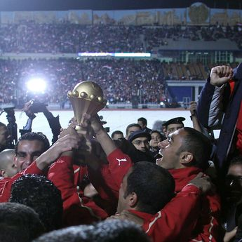 Egyptian captain Ahmed Hassan and teammates raise the trophy of the African Cup of Nations