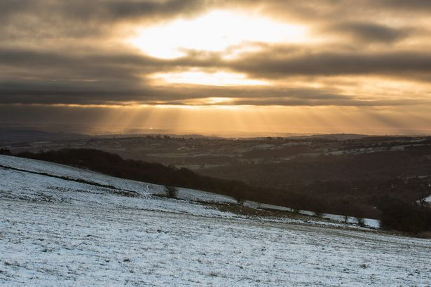 Temperatures in Britain plunged to -15C making it the coldest night of the year. Pictured the sun bursting through the clouds over the Derbyshire Dales