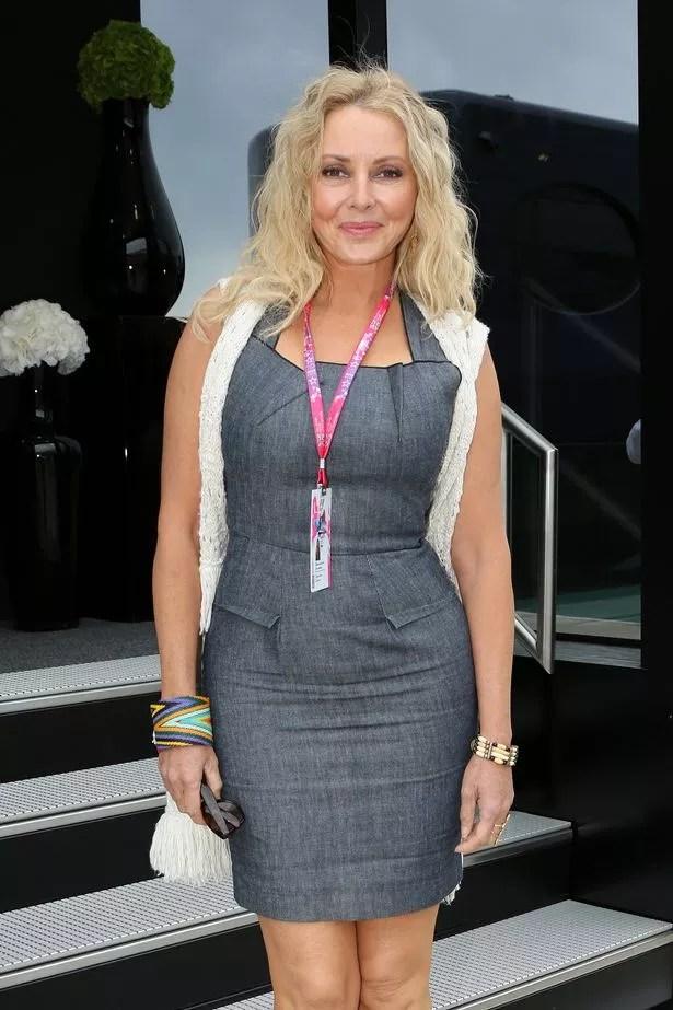 Carol Vorderman arrives before the 2015 British Grand Prix at Silverstone Circuit