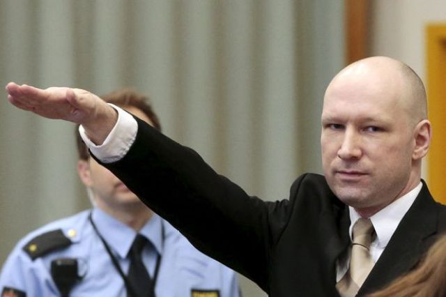 Mass killer Anders Behring Breivik raises his arm in a Nazi salute as he enters the court room