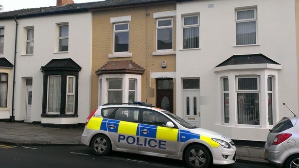 Police at a property in Blackpool, where detectives investigated the death of Freddie Neil