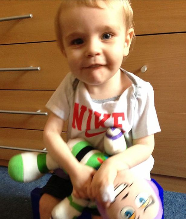 Liam Fee with his favourite Buzz Lightyear toy