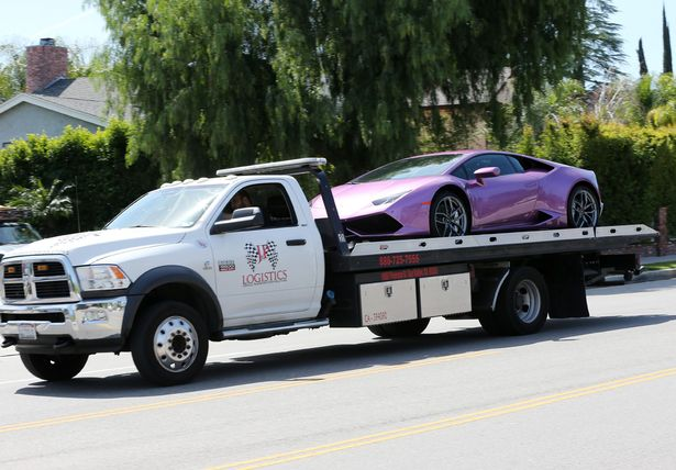 Rob Kardashian buys Blac Chyna a purple Lamborghini, The car gets delivered to her house in Los Angeles
