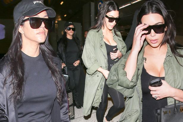 Kim and Kourtney Kardashian arriving at LAX. They arrive surrounded by fans. <P> Pictured: Kim Kardashian, Kourtney Kardashian <B>Ref: SPL1267630 200416 </B><BR/> Picture by: Reefshots / Splash News<BR/> </P><P> <B>Splash News and Pictures</B><BR/> Los Angeles: 310-821-2666<BR/> New York: 212-619-2666<BR/> London: 870-934-2666<BR/> photodesk@splashnews.com<BR/> </P>