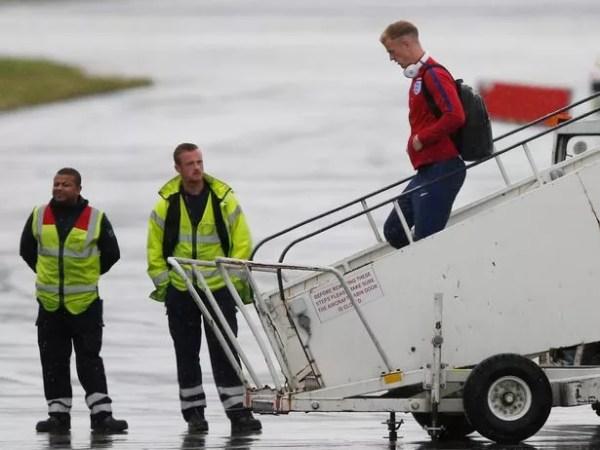 England's Joe Hart arrives back at Manchester Airport
