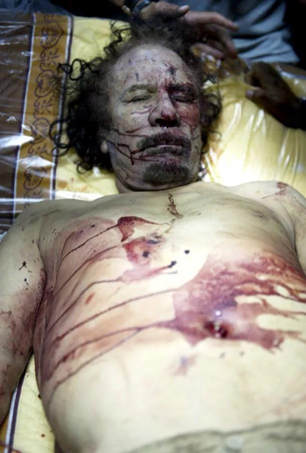 https://i1.wp.com/i2.mirror.co.uk/incoming/article86897.ece/BINARY/the-body-of-colonel-gaddafi-pic-rex-486010065.jpg