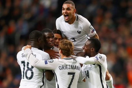 Paul Pogba is congratulated by teammates after scoring