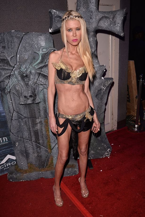 Tara Reid shows off her super slim frame in a Greek goddess costume at Halloween party