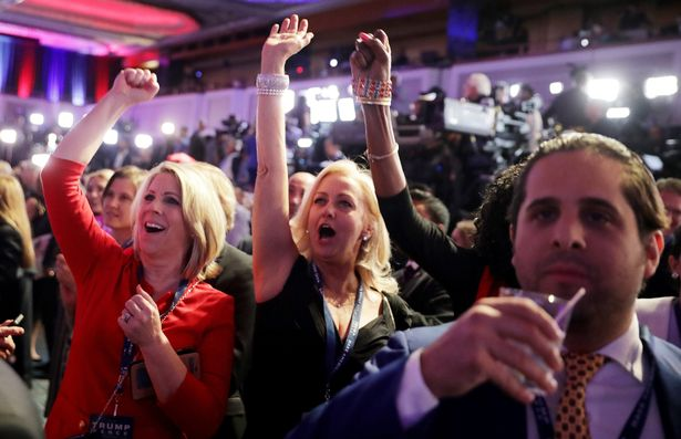 Supporters of Republican presidential nominee Donald Trump cheer during the election night event at the New York Hilton Midtown