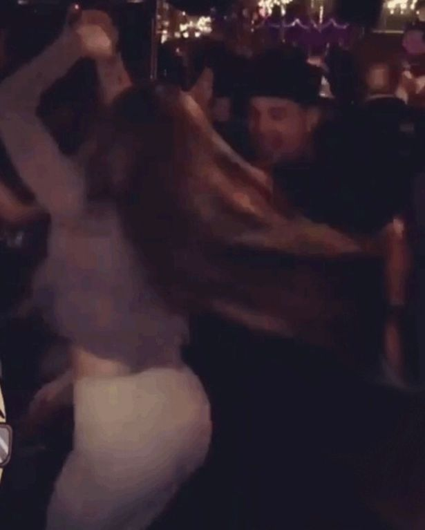 J Lo salsa dancing with mystery man