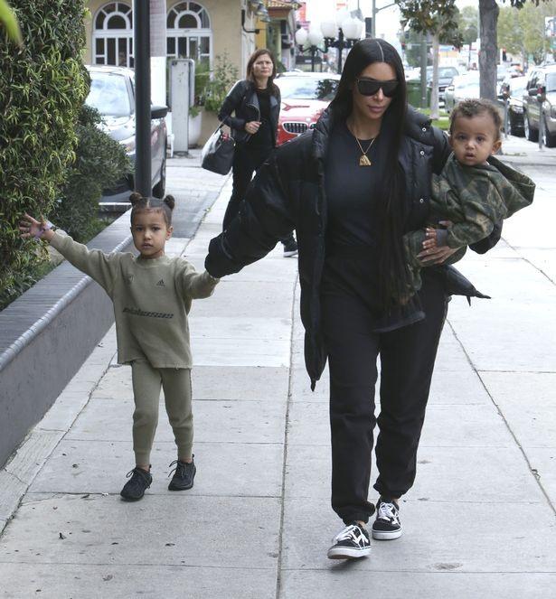Kim and Kourtney Kardashian take their kids to have lunch with Kim's husband Kanye West at Something's Fishy in Woodland Hills, California.
