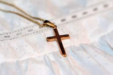 Royalty-Free photo: Gold-colored cross pendant | PickPik