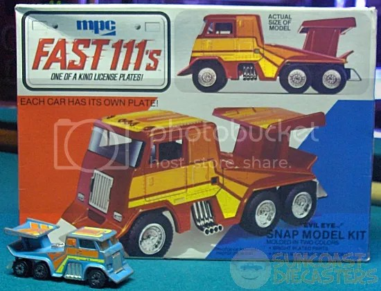 The normal-size diecast version in light blue is from Bill. Note lack of bed-dumping handle.