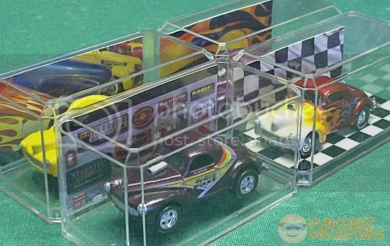 Creative background cards may create the illusion of a showroom, raceway or other diorama-like appearance.
