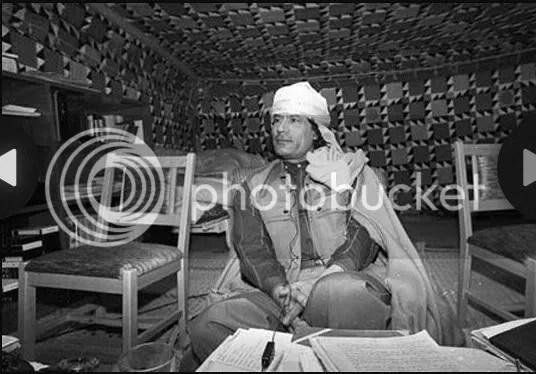 Gadhafi preparing his notes in his Tent