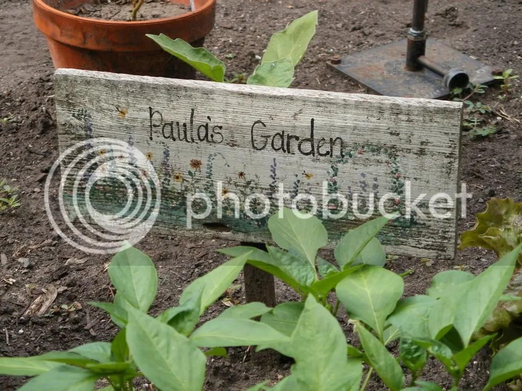 Paula's Garden wooden sign