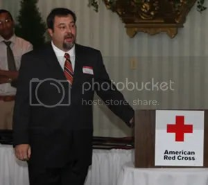 Volunteer Tony Gasparini speaks at a donor appreciation event.