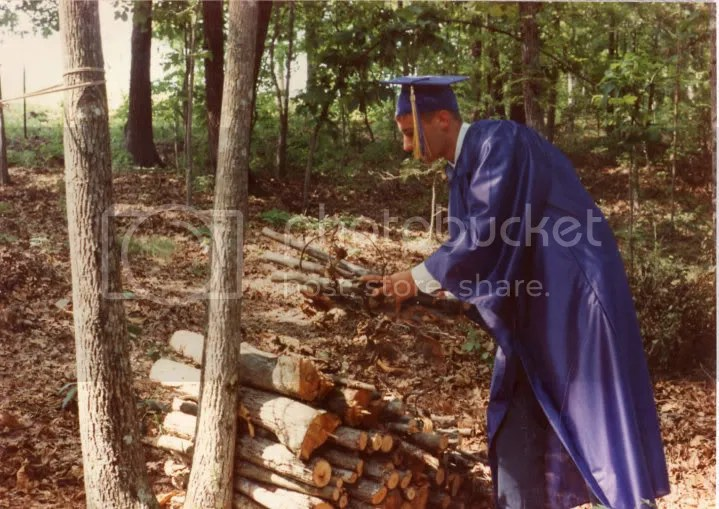 Jason stacking wood before graduation