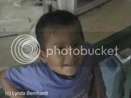 Boy looking into camera (c) Lynda Bernhardt