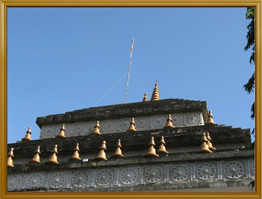 A close up view of the roof of the temple.  Notice the bell-shaped figures and the clean blue sky.  Not a single white cloud in sight.