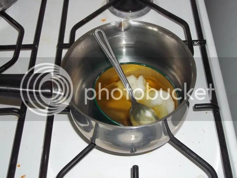 Melt it in boiling water.